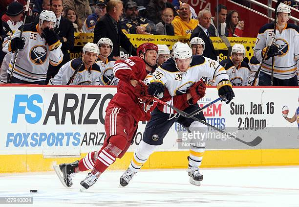Thomas Vanek of the Buffalo Sabres fights off Ed Jovanovski of the Phoenix Coyotes as he goes after the puck on January 8, 2011 at Jobing.com Arena...