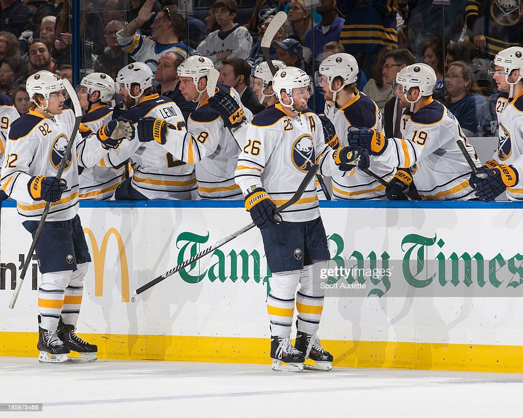 Thomas Vanek #26 of the Buffalo Sabres is congratulated by teammates after his goal against the Tampa Bay Lightning during the third period at the Tampa Bay Times Forum on October 26, 2013 in Tampa, Florida.
