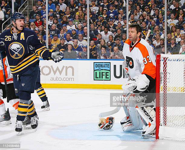 Thomas Vanek of the Buffalo Sabres protests the stoppage of play after goaltender Brian Boucher of the Philadelphia Flyers removed his mask in Game...
