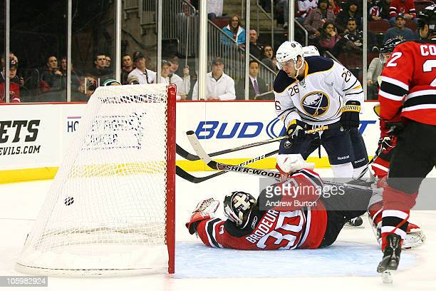Thomas Vanek of the Buffalo Sabres scores against Martin Brodeur of the New Jersey Devils in the third period on October 23, 2010 at the Prudential...