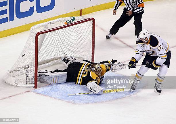 Thomas Vanek of the Buffalo Sabres scores his third goal of the game against Tuukka Rask of the Boston Bruins during a game at the TD Garden on...