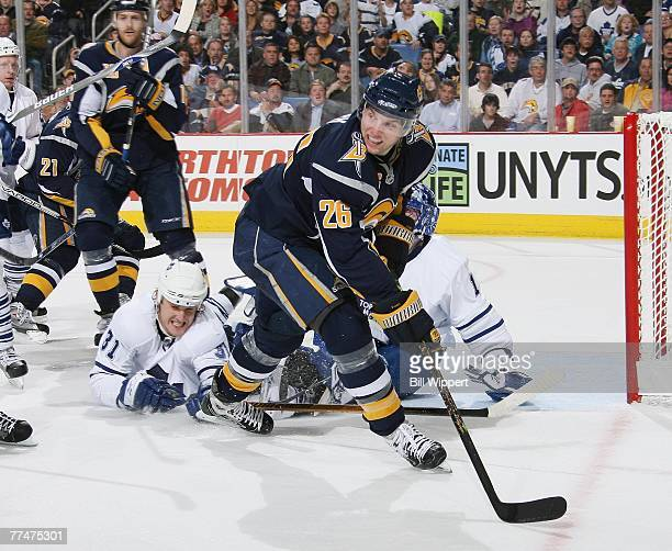 Thomas Vanek of the Buffalo Sabres skates past the fallen Pavel Kubina of the Toronto Maple Leafs on October 15, 2007 at HSBC Arena in Buffalo, New...