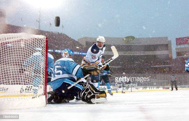 Thomas Vanek of the Buffalo Sabres tries to get past goaltender Ty Conklin of the Pittsburgh Penguins during the NHL Winter Classic at the Ralph...