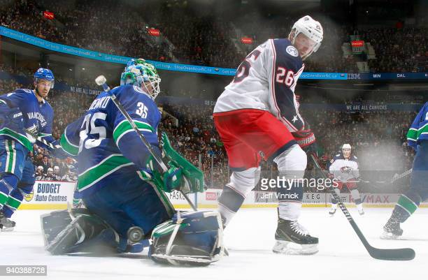 Thomas Vanek of the Columbus Blue Jackets looks on as Thatcher Demko of the Vancouver Canucks makes a save during their NHL game at Rogers Arena...