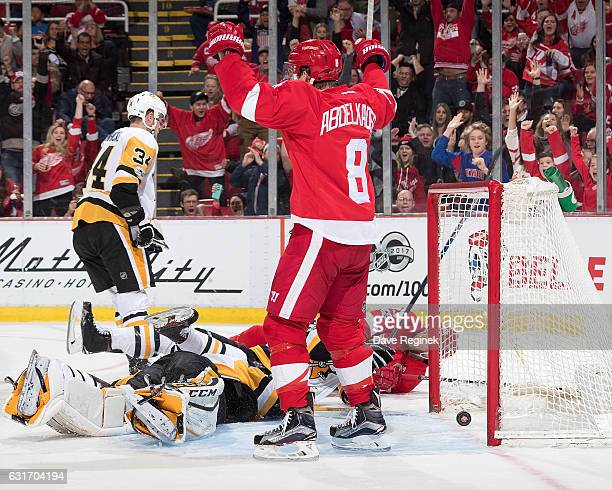 Thomas Vanek of the Detroit Red Wings scores a second period goal on Marc-Andre Fleury of the Pittsburgh Penguins as teammate Justin Abdelkader of...