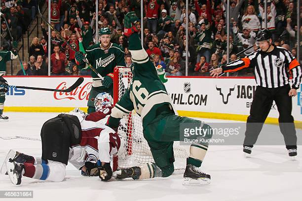 Thomas Vanek of the Minnesota Wild scores a goal against Brad Stuart and goalie Reto Berra of the Colorado Avalanche during the game on March 8 2015...