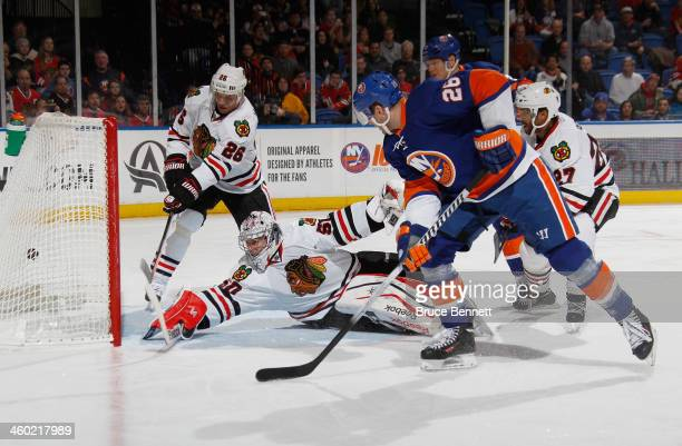 Thomas Vanek of the New York Islanders scores at 8:09 of the second period against Corey Crawford of the Chicago Blackhawks at the Nassau Veterans...
