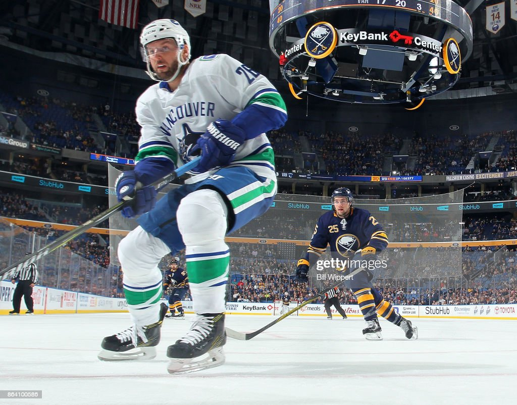 Thomas Vanek #26 of the Vancouver Canucks chases the puck against Seth Griffith #25 of the Buffalo Sabres during an NHL game on October 20, 2017 at KeyBank Center in Buffalo, New York. Vancouver won, 4-2.