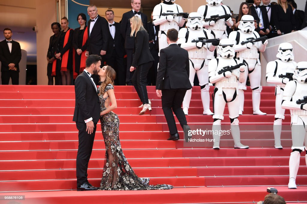 Thomas Vergara and Nabilla Benattia kiss on the steps as stormtroopers look on at the screening of 'Solo: A Star Wars Story' during the 71st annual Cannes Film Festival at Palais des Festivals on May 15, 2018 in Cannes, France.