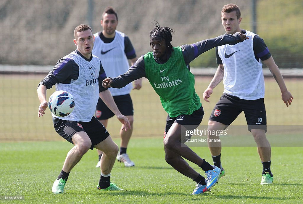 Thomas Vermaelen and Gervinho of Arsenal during a training session at London Colney on April 26, 2013 in St Albans, England.