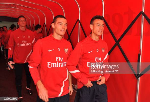 Thomas Vermaelen and Laurent Koscielny of Arsenal before the Arsenal training session and Membersday at Emirates Stadium on August 4 2011 in London...
