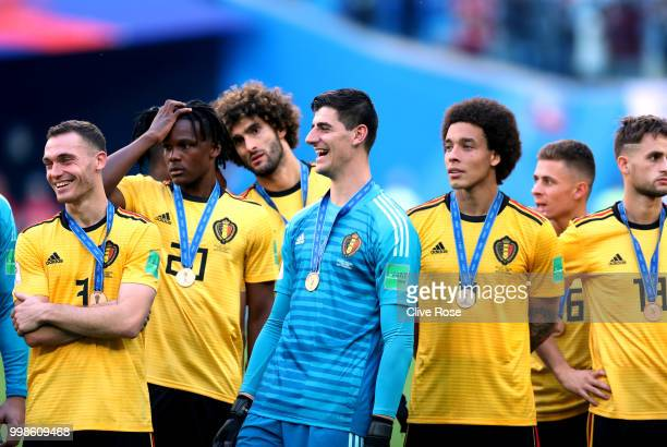 Thomas Vermaelen Dedryck Boyata Marouane Fellaini Thibaut Courtois and Axel Witsel of Belgium celebrate victory following the 2018 FIFA World Cup...