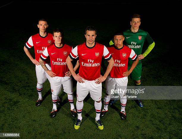 Thomas Vermaelen Jack Wilshere Robin van Persie Alex OxladeChamberlain and Wojciech Szczesny pose during a photoshoot for the new Arsenal home kit...