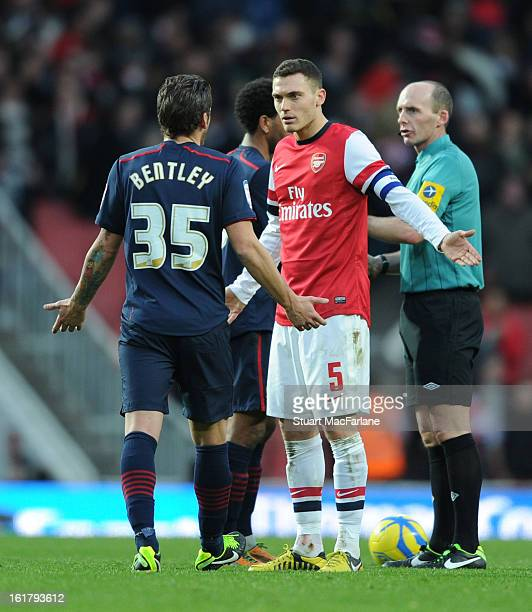Thomas Vermaelen of Arsenal and David Bentley of Blackburn exchange words during the FA Cup Fifth Round match between Arsenal and Blackburn Rovers at...