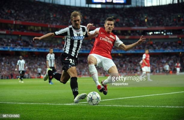 Thomas Vermaelen of Arsenal and Joel Ekstrand of Udinese in action during the UEFA Champions League play-off first leg match between Arsenal and...