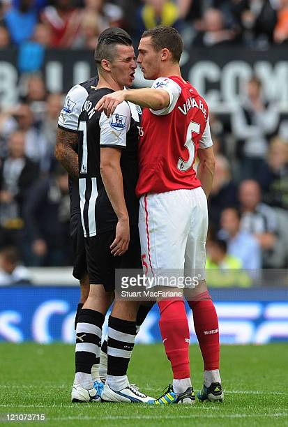 Thomas Vermaelen of Arsenal argues with Joey Barton of Newcastle after Gervinho is sent off during the Barclays Premier League match between...
