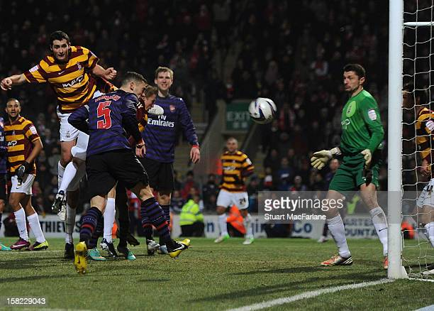 Thomas Vermaelen of Arsenal heads past Bradford goalkeeper Matt Duke to score the Arsenal goal during the Capital One Cup match between Arsenal and...