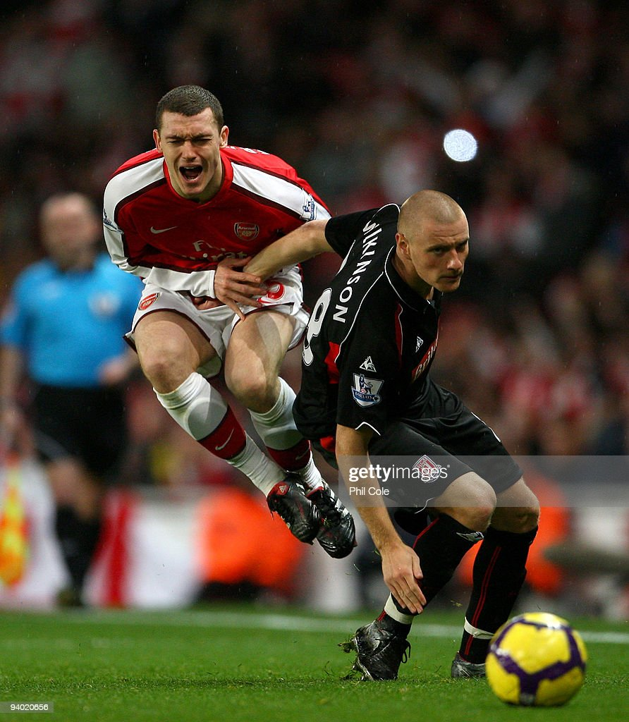 Thomas Vermaelen of Arsenal is tackled by Andy Wilkinson of Stoke City during the Barclays Premier League match between Arsenal and Stoke City at the Emirates Stadium on December 5, 2009 in London, England.