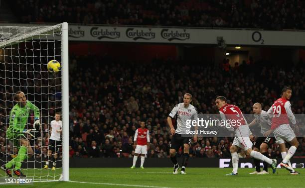 Thomas Vermaelen of Arsenal scores their first goal past Mark Schwarzer of Fulham during the Barclays Premier League match between Arsenal and Fulham...