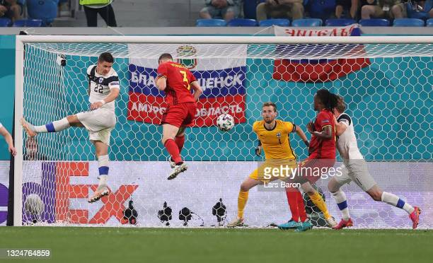 Thomas Vermaelen of Belgium headers on target, before Lukas Hradecky of Finland then scores an own goal, Belgium's first goal, as he fails to make a...