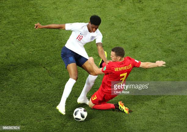 Thomas Vermaelen of Belgium tackles Marcus Rashford of England during the 2018 FIFA World Cup Russia group G match between England and Belgium at...