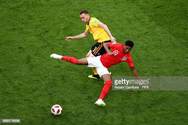 Thomas Vermaelen of Belgium tackles Marcus Rashford of England during the 2018 FIFA World Cup Russia 3rd Place Playoff match between Belgium and...