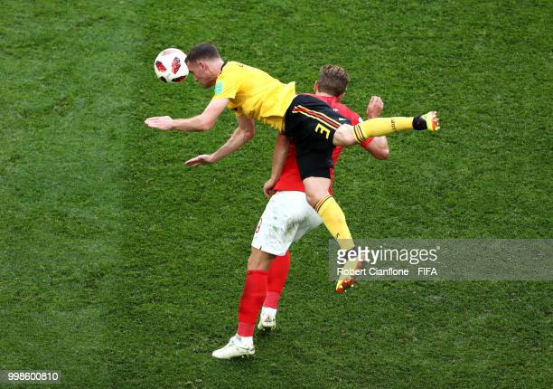 Thomas Vermaelen of Belgium wins a header over Harry Kane of England during the 2018 FIFA World Cup Russia 3rd Place Playoff match between Belgium...