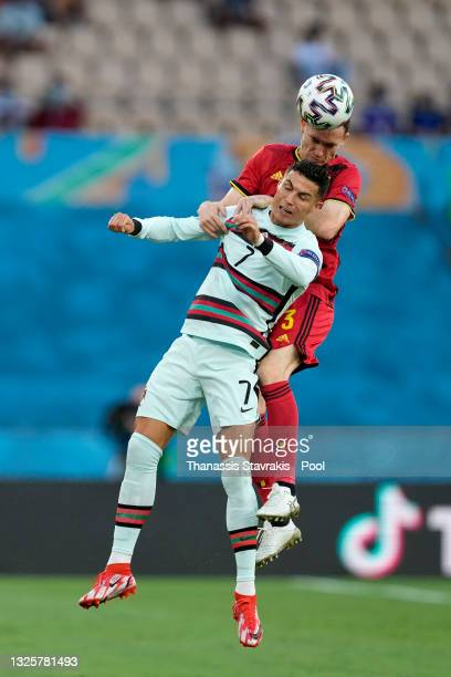 Thomas Vermaelen of Belgium wins a header whilst under pressure from Cristiano Ronaldo of Portugal during the UEFA Euro 2020 Championship Round of 16...