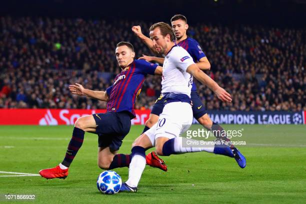 Thomas Vermaelen of FC Barcelona attempts to block a shot from Harry Kane of Tottenham Hotspur during the UEFA Champions League Group B match between...