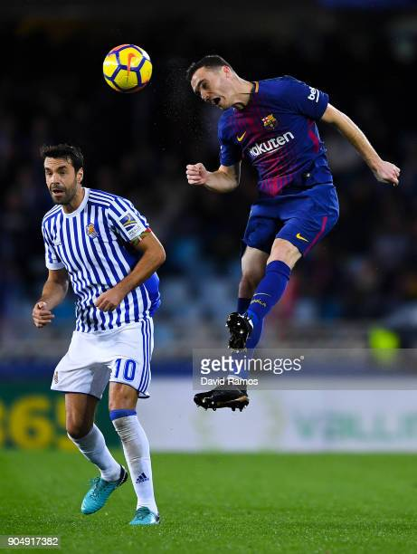 Thomas Vermaelen of FC Barcelona competes for the ball with Xabi Prieto of Real Sociedad de Futbol during the La Liga match between Real Sociedad and...