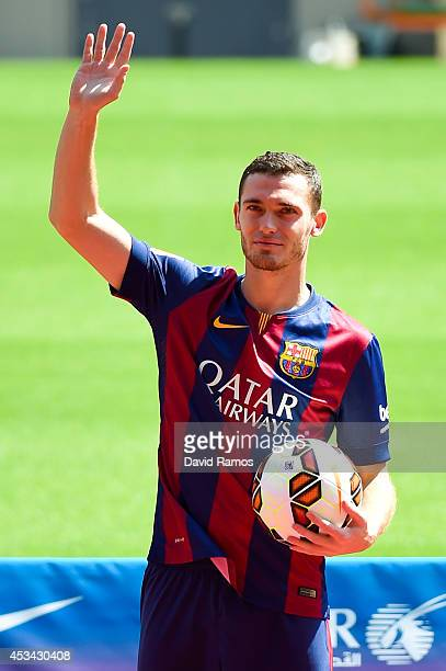 Thomas Vermaelen poses as he is unveiled as a new player for FC Barcelona at the Camp Nou stadium on August 10, 2014 in Barcelona, Spain.