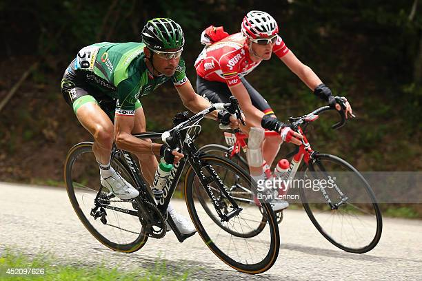 Thomas Voeckler of France and Team Europcar and Jurgen Van Den Broeck of Belgium and Team Lotto Belisol in action during the ninth stage of the 2014...
