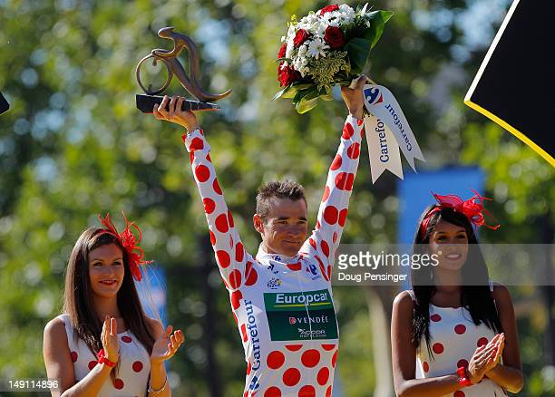 Thomas Voeckler of France and Team Europcar celebrates on the podium after securing the polka dot jersey for the King of the Mountains competition...