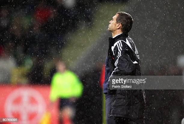 Thomas von Heesen of Nuernberg gestures in the rain during the Bundesliga match between Bayer Leverkusen and 1FC Nuernberg at the Veltins BayArena on...