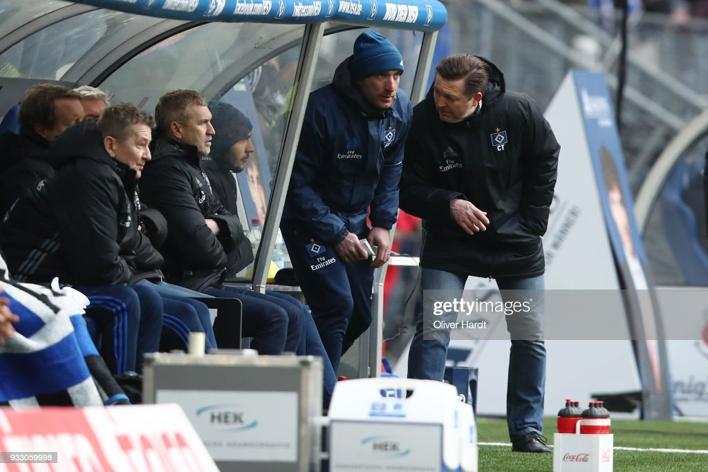 Thomas von Heesen, Soner Uysal and Head coach Christian Titz of Hamburg gesticulated during the Bundesliga match between Hamburger SV and Hertha BSC at Volksparkstadion on March 17, 2018 in Hamburg, Germany.
