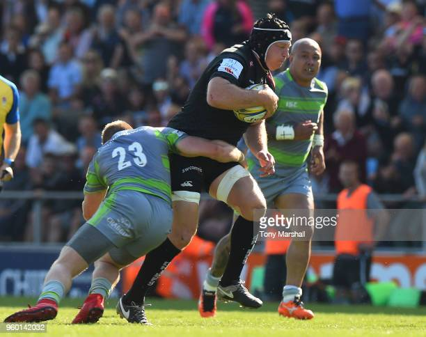 Thomas Waldrom of Exeter Chiefs is tackled by Alex Tait of Newcastle Falcons during the Aviva Premiership Semi Final between Exeter Chiefs and...