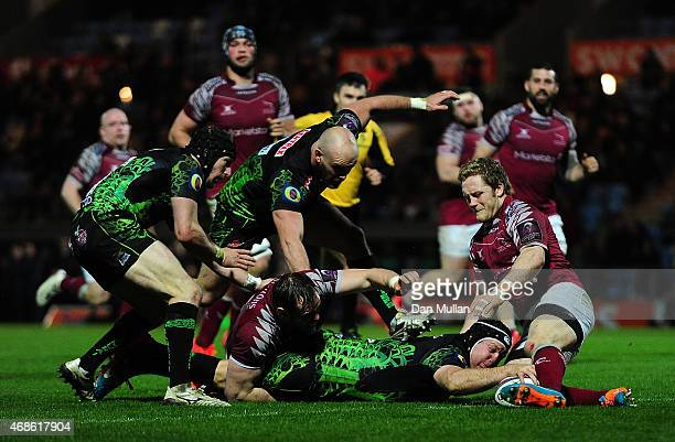 Thomas Waldrom of Exeter Chiefs stretches over for a try during the European Rugby Challenge Cup match between Exeter Chiefs and Newcastle Falcons at...