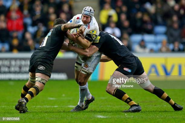 Thomas Waldrom of Exeter Chiefs tackled by Guy Thompson and Will Rowlands of Wasps during the Aviva Premiership match between Wasps and Exeter Chiefs...