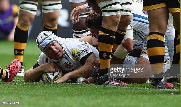 Thomas Waldrom of Exeter dives over for the first try during the Aviva Premiership match between Wasps and Exeter Chiefs at the Ricoh Arena on...