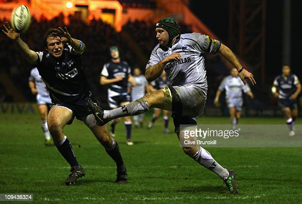 Thomas Waldrom of Leicester Tigers clears the ball from Henry Thomas of Sale Sharks during the AVIVA Premiership match between Sale Sharks and...