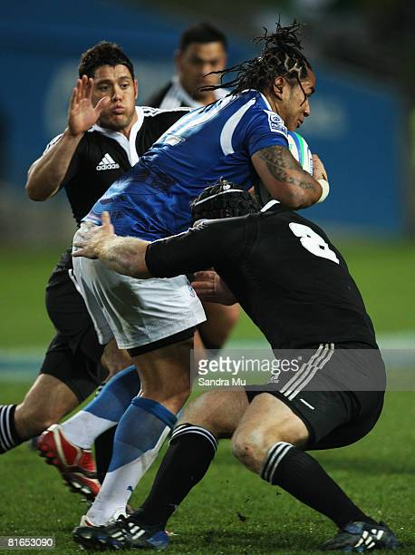 Thomas Waldrom of New Zealand makes a tackle on George Stowers of Samoa during the 2008 Pacific Nations Cup match between the New Zealand Maori and...