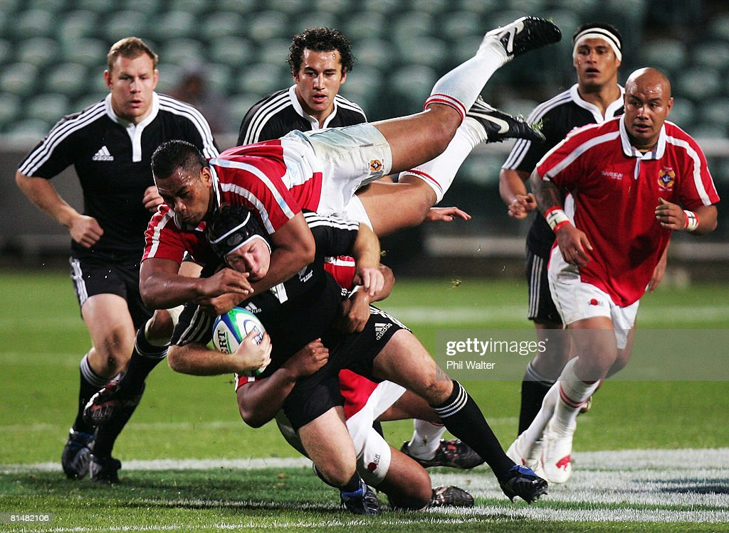 Thomas Waldrom of New Zealand Maori is tackled by Epeli Taione of Tonga during the 2008 Pacific Nations Cup match between the New Zealand Maori and Tonga at North Harbour Stadium on June 7, 2008 in Auckland, New Zealand.