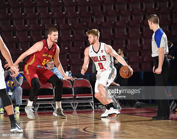 Thomas Walkup of the Windy City Bulls dribbles the ball against Adam Woodbury of the Fort Wayne Mad Ants as part of 2017 NBA DLeague Showcase at the...