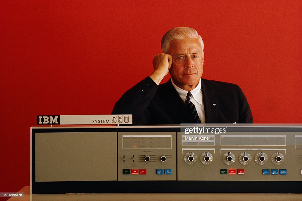 Thomas Watson Jr. of International Business Machines (IBM) posing with a System 360 computer, September, 1966. The IBM System 360 was one of the first general purpose, upgradable mainframe computers. At the time it was introduced in 1964 it was the second most expensive project on the 1960s