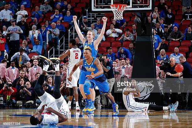 Thomas Welsh and Norman Powell of the UCLA Bruins reacts after defeating the Southern Methodist Mustangs during the second round of the 2015 NCAA...