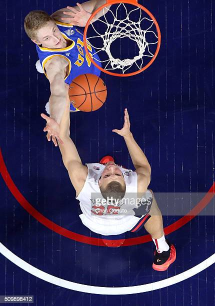 Thomas Welsh of the UCLA Bruins fights for a rebound with Kaleb Tarczewski of the Arizona Wildcats during the second half of the college basketball...