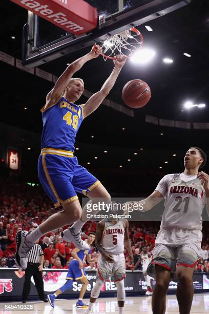 Thomas Welsh of the UCLA Bruins slam dunks the ball over Chance Comanche of the Arizona Wildcats during the second half of the college basketball...