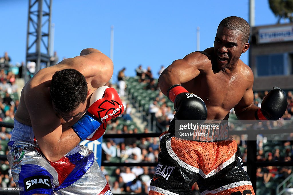 Thomas Williams Jr.(R) punches Edwin Rodriguez during a light heavyweight fight at StubHub Center on April 30, 2016 in Carson, California.