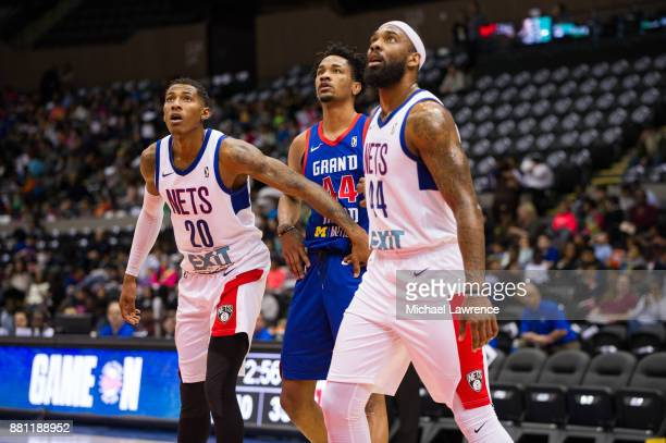 Thomas Wimbush and Luis Montero of the Long Island Nets wait for a rebound during an NBA GLeague game against the Grand Rapid Drive on November 28...