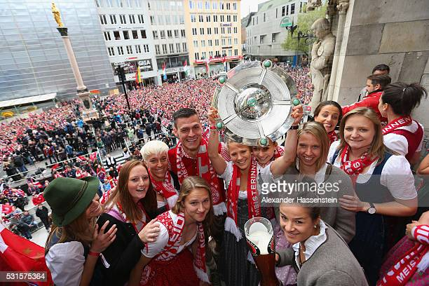 Thomas Woerle head coach of Bayern Muenchen women`s celebrates with his players winning the German Championship title on the town hall balcony at...